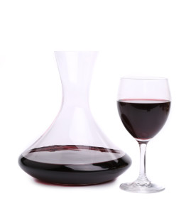 Decanter with red wine and glass